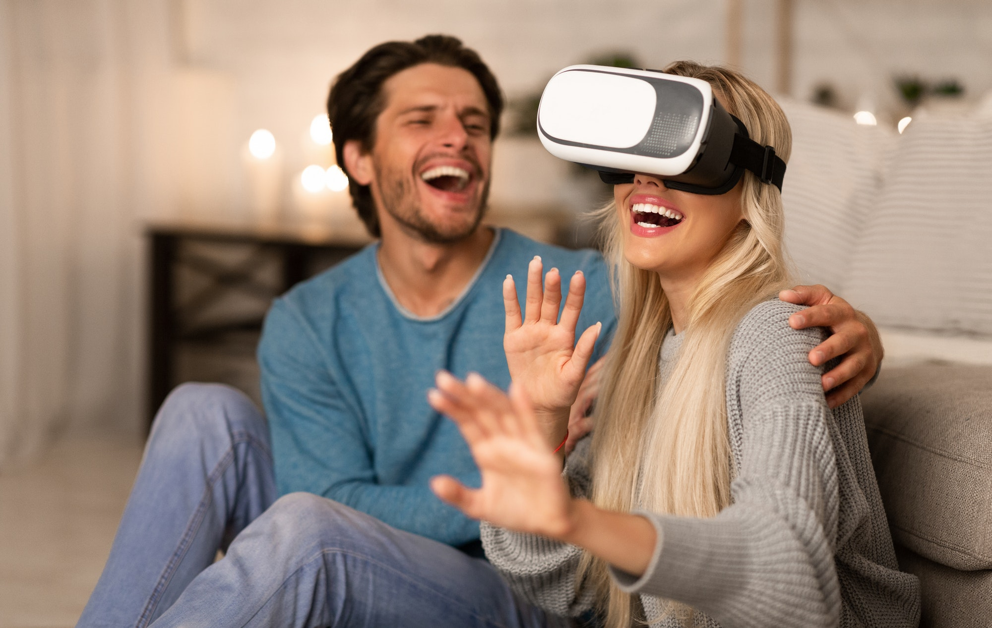 Millennial Couple Experiencing Virtual Reality At Home